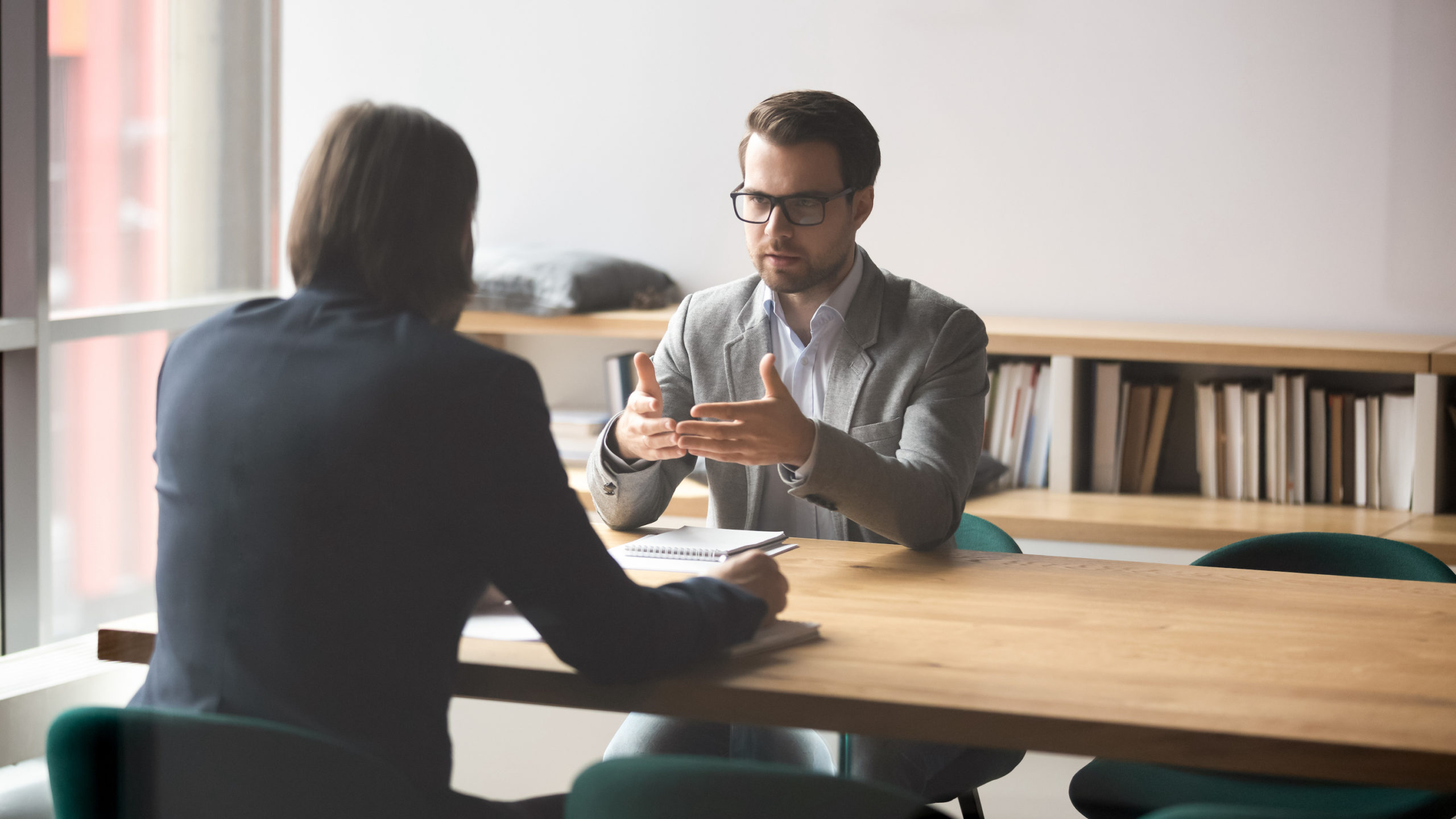 derivative lawsuit concept Two successful male partners negotiation project ideas in boardroom.